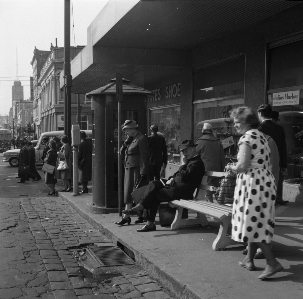 N19 People at bus stop on a Melbourne Street